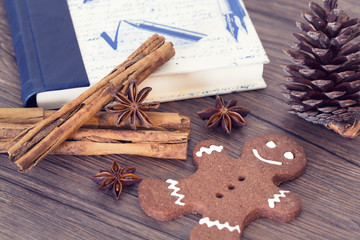 Gingerbread man, cookies, star anise, cinnamon and cookbook