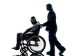 injured man in wheelchair with nurse silhouette