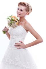 Beautiful bride with wedding bouquet isolated on white.
