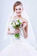Bride portrait.Wedding dress. Wedding flowers