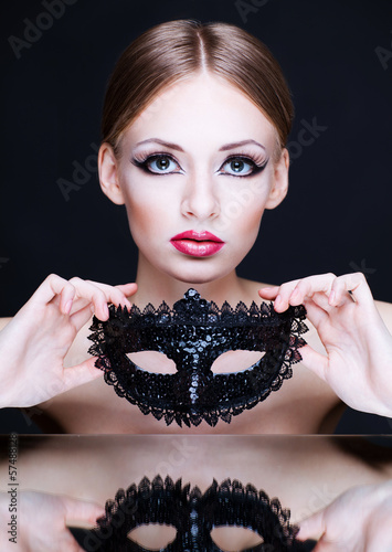 young beauty woman with mask on dark background
