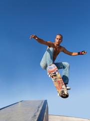 boy flying on a skateboard