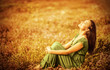 Romantic woman on golden field