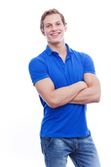 Portrait of a young handsome man wearing blue t-short isolated o