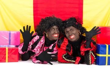 Two Zwarte Pieten lying