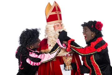 Zwarte Piet giving pepernoten (cookies) to Sinterklaas