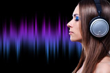 young DJ woman enjoying the music in the headphones