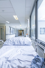 Empty Bed Gurney in Hospital Corridor