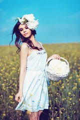 Young beautiful woman in a summer field
