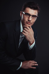 young businessman wearing glasses. Studio shoot.