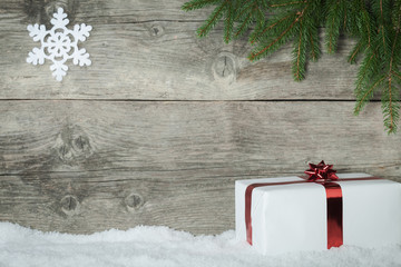 Christmas Presenton an old wooden background with snowflake