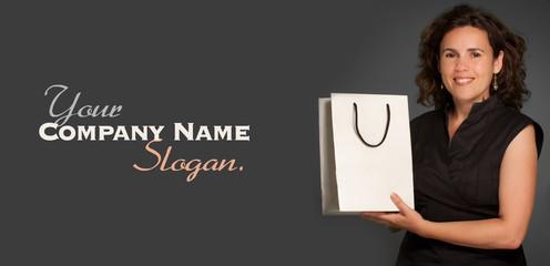 Woman presenting a shopping bag