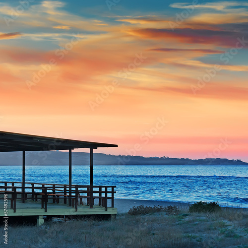wooden porch at sunset - 57492596