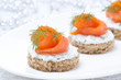 canape with rye bread, cream cheese, salmon and greens
