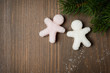 Christmas wooden background with sugar little men