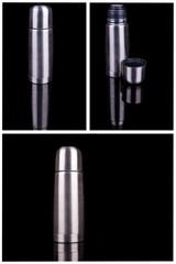 metal thermos on black