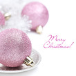 pink Christmas ball and tinsel close-up, isolated
