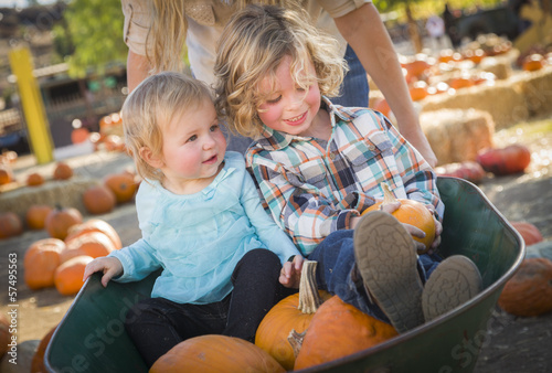 Young Kids Enjoy a Day at the Pumpkin Patch