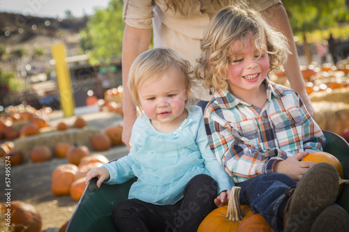 Young Family Enjoys a Day at the Pumpkin Patch