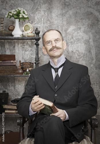 Portrait of man with a book