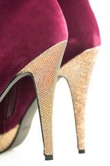 Close up of High Heels shoes in red and gold