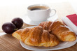 Two croissants and cup of coffee