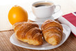 Coffee break with croissant