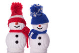 couple of snowman with red and blue hat and scarf