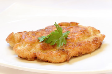 Schnitzel on white plate