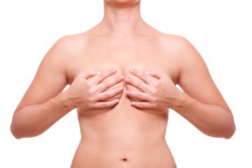 weibliche Brust verdeckt mit den Händen