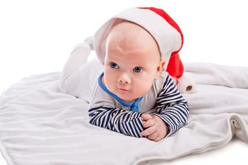 Cute baby boy in Santa`s hat