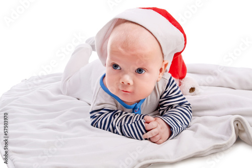 Cute baby boy in Santa`s hat