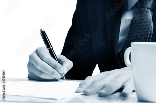 Completing the Form on White Table