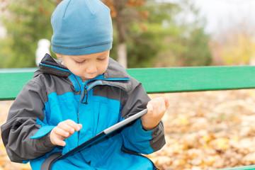 Little boy using a tablet-pc