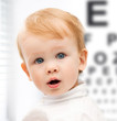 adorable baby child with eyesight testing board