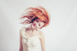 red haired expressive emotional female with flying hair