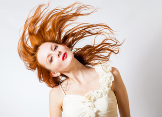 red haired expressive female with flying hair