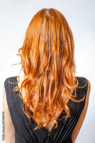 Back view of Red curly long hair Beautiful Woman