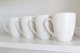 white cups on the shelf