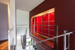 Red lighted wall in modern house