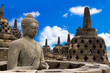 Buddha in Borobudur Temple against blue sky with clouds