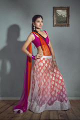 Beautiful Indian bride in colorful dress lehenga.
