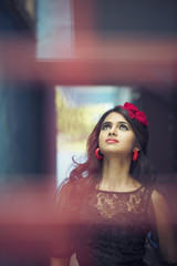 Beautiful Indian girl wearing Black Gown in outdoor background.
