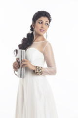 beautiful young woman in white evening dress and Clutch