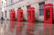 London, UK - red telephone booths at Broad Court
