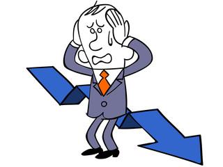 下がる矢印と頭を抱えるビジネスマン