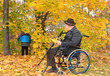 Disabled grandfather and grandchild outdoors