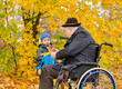 Elderly disabled man playing with his grandson