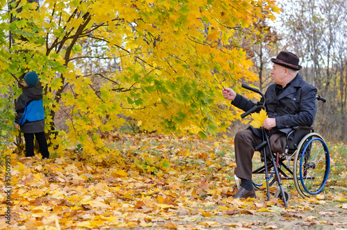 Disabled grandfather and grandchild outdoors playing