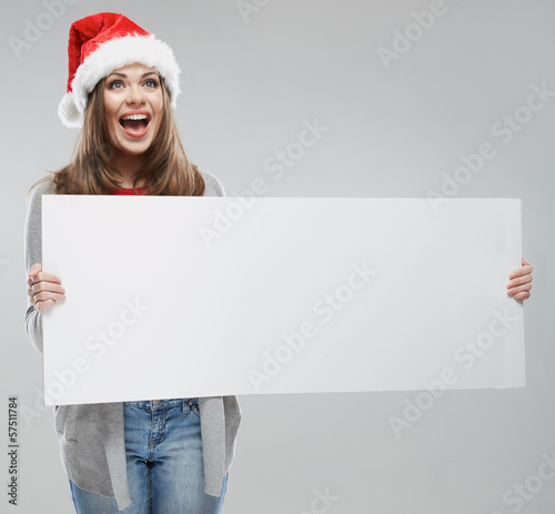 Christmas woman hold big white card. Santa hat. Isolated